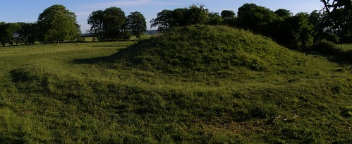 Round Barrows are small circular mounds that cover an individual burial or cremation. Image Credit - Jim Champion.