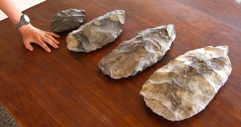 Four giant stone hand axes were recovered from the the dry basin of Lake Makgadikgadi in the Kalahari Desert. Image Courtesy of The University of Oxford.