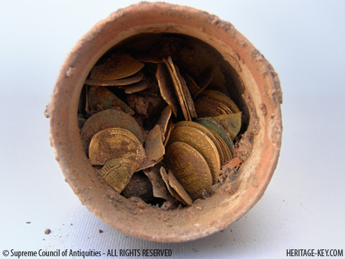 Polish excavators have found a clay vessel containing dozens of gold coins in Egypt. Image Credit - SCA.