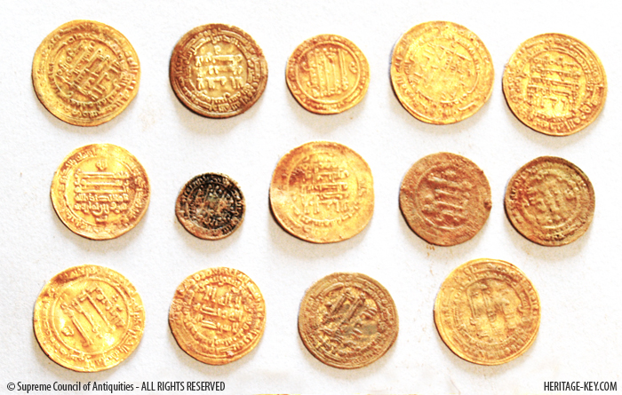 The hoard's 18 coins and 62 coin fragments are dated to Egypt's Abbasid Period. Image Credit - SCA.