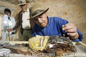 Dr. Zahi Hawass examines a mummy. Image Copyright - Sandro Vannini