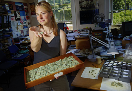 Dr Alice Roberts, presenter of 'Digging for Britain', with a hoard of Roman Coins found in Somerset in 2010 - Image copyright 360 Production Photo by Mike Hogan