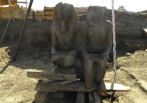 Statue of Amenhotep III and sun god Re-Horakhti discovered a the pharaoh's funerary temple at Luxor