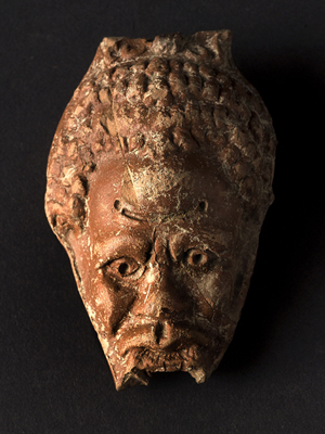 Reservoir of an anthropomorphic oil lamp, with Nubian head. - Image Copyright Herv Paitier INRAP