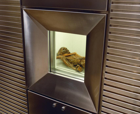 A 40x30 cm wall opening allows visitors to the South Tyrol Museum to take a look into the refrigeration chamber in which the mummy is conserved at a temperature of -6 degrees Celcius and 98 percent air humidity. - Image courtesy the South Tyrol Museum of Archaeology