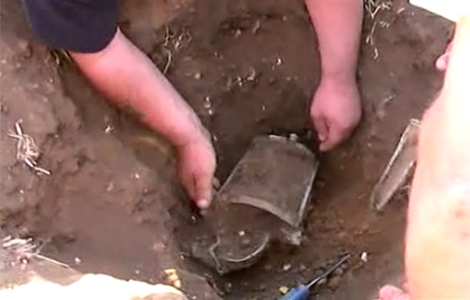 Archaeologists excavate the only complete Roman lantern to have been discovered in the UK. Click the image to skip down to the video to the artefact being uncovered.